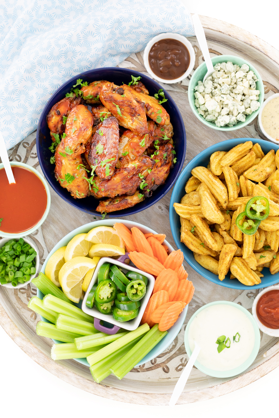 chicken wing buffet with blue cheese, celery, carrots, green onions and selection of dips