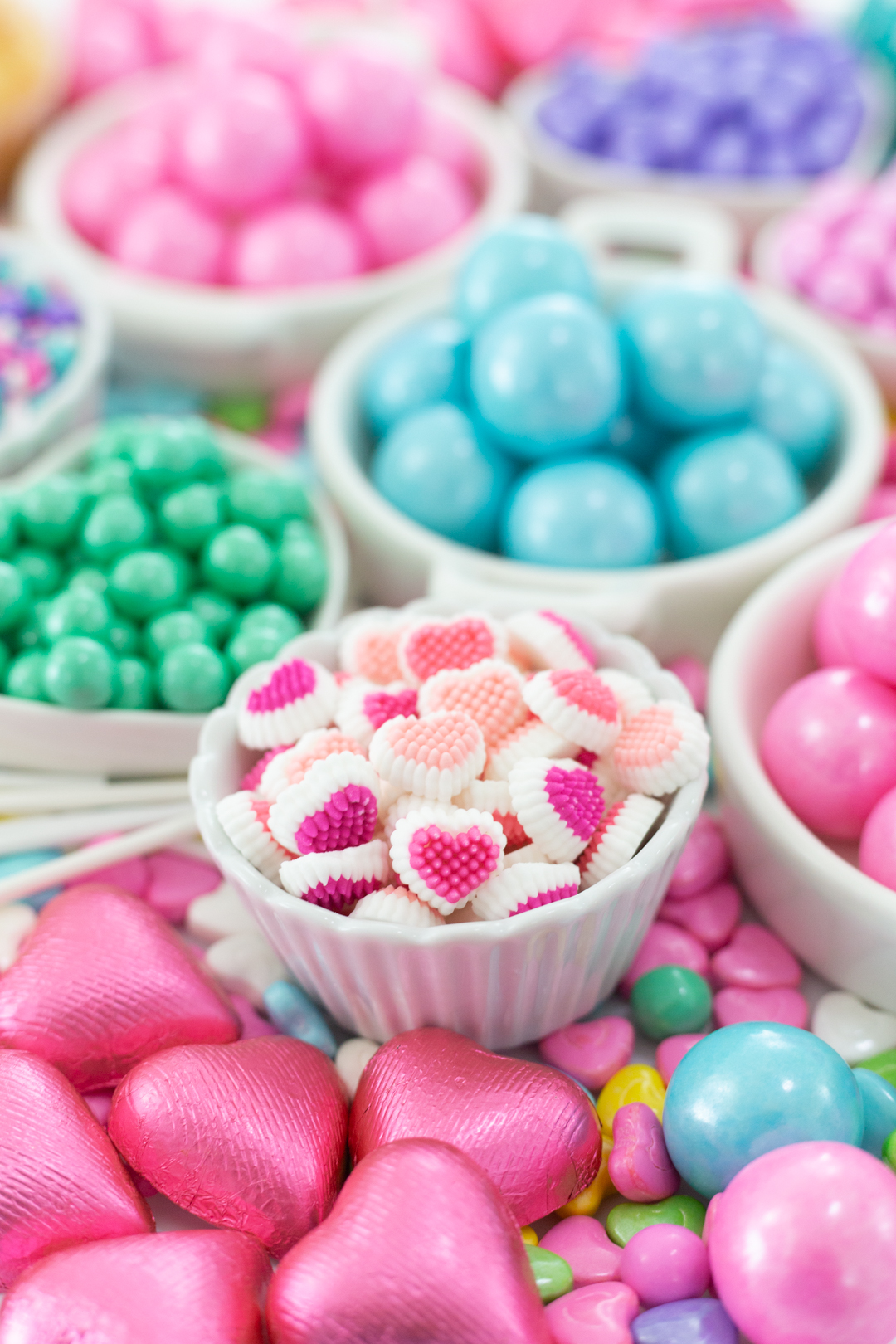 dish filled with pastel valentine's day candies and icing decorations