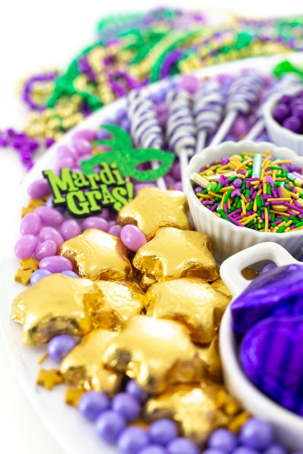 gorgeous tray of mardi gras themed candies. Pretty gold star chocolates and king cake inspired sprinkles from Fancy Sprinkles.