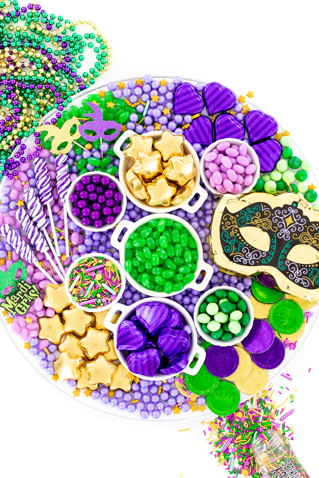 mardi gras candy charcuterie board made with green, purple and gold candies.