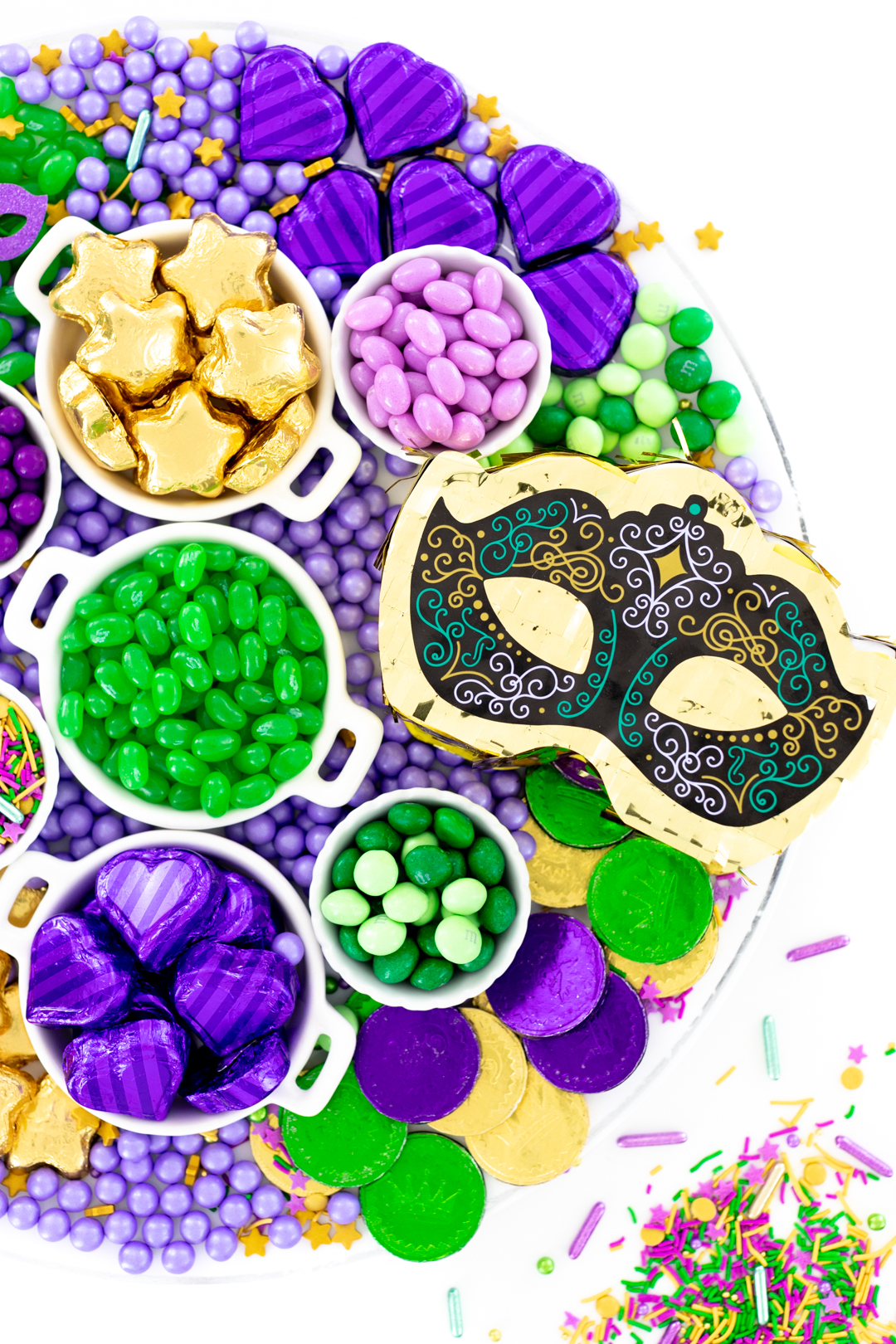 cute tray of mardi gras candy with mini pinata