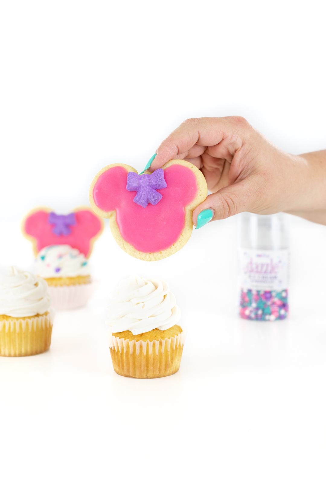 topping a cupcake with a sugar cookie