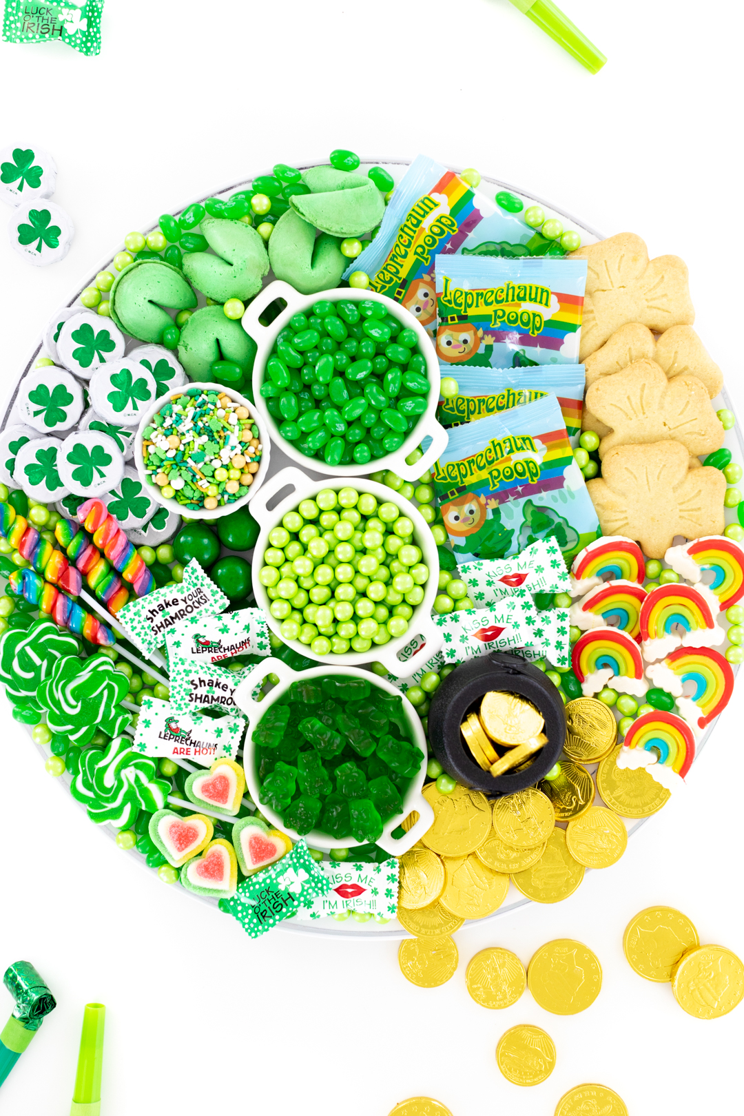 St. Patrick's Day candy board with green, rainbow and gold candies.