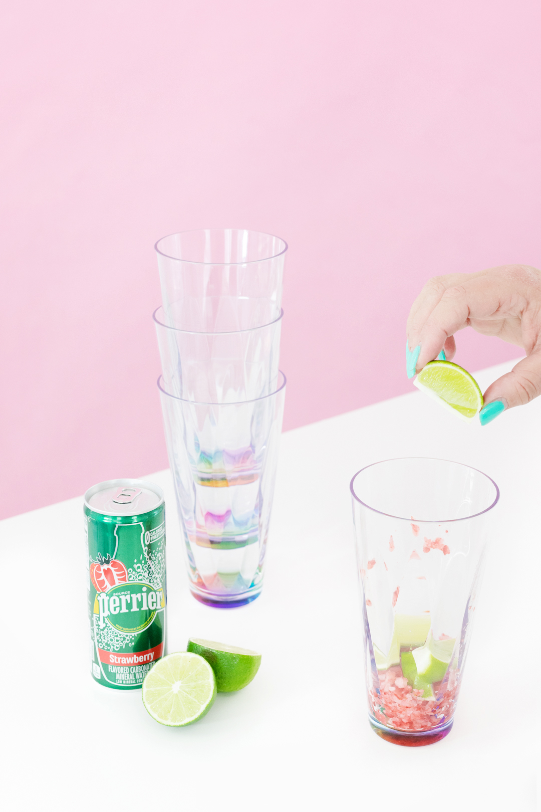 squeezing lime into cup