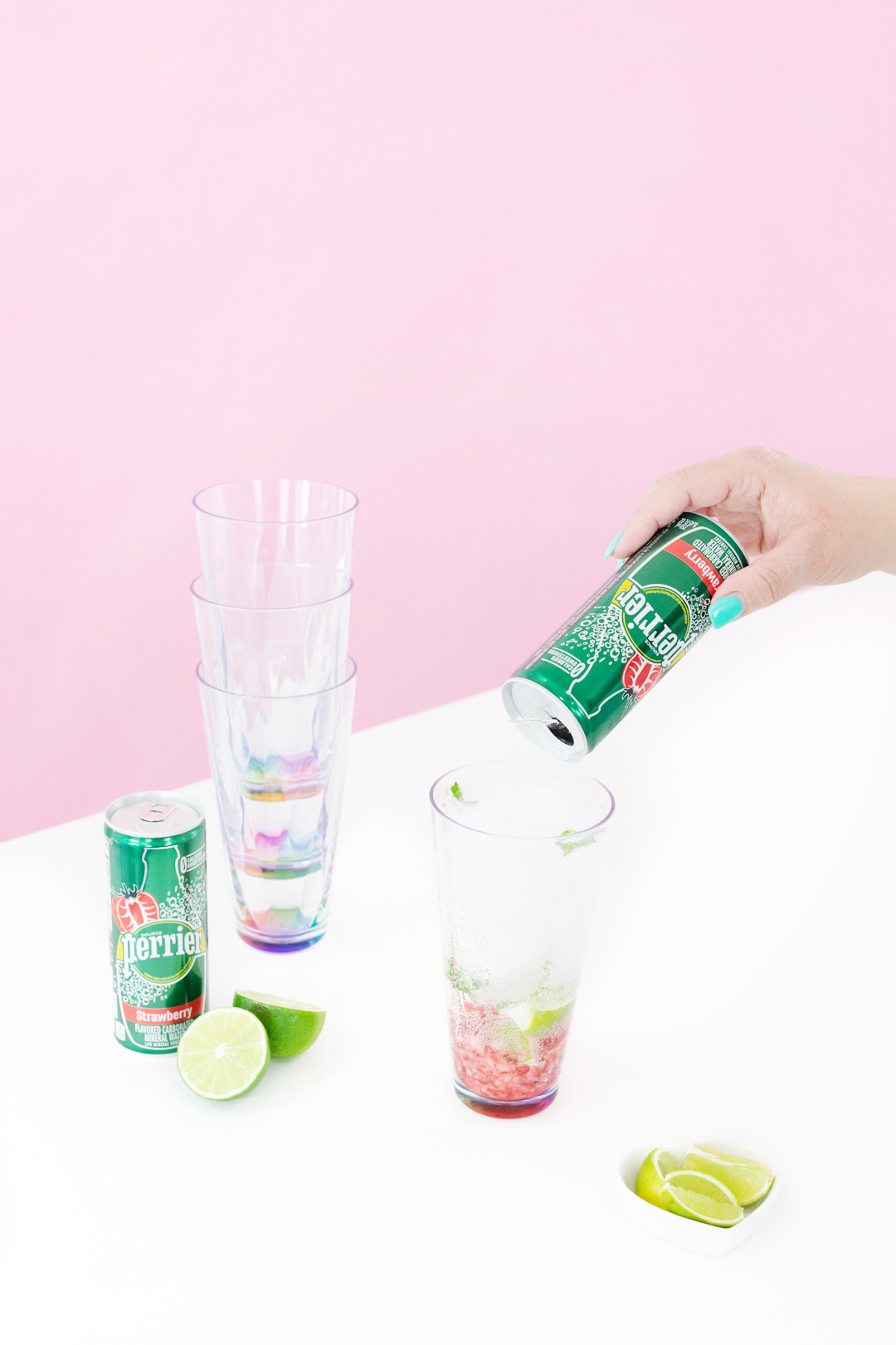 pouring can of perrier into cup