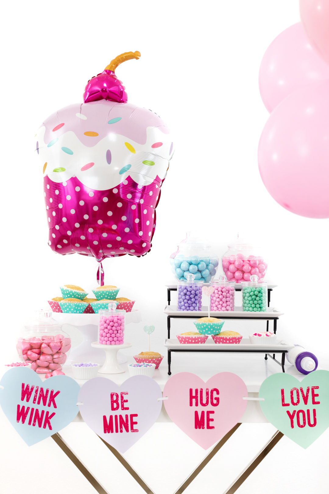 cupcake party spread with giant cupcake shaped balloon