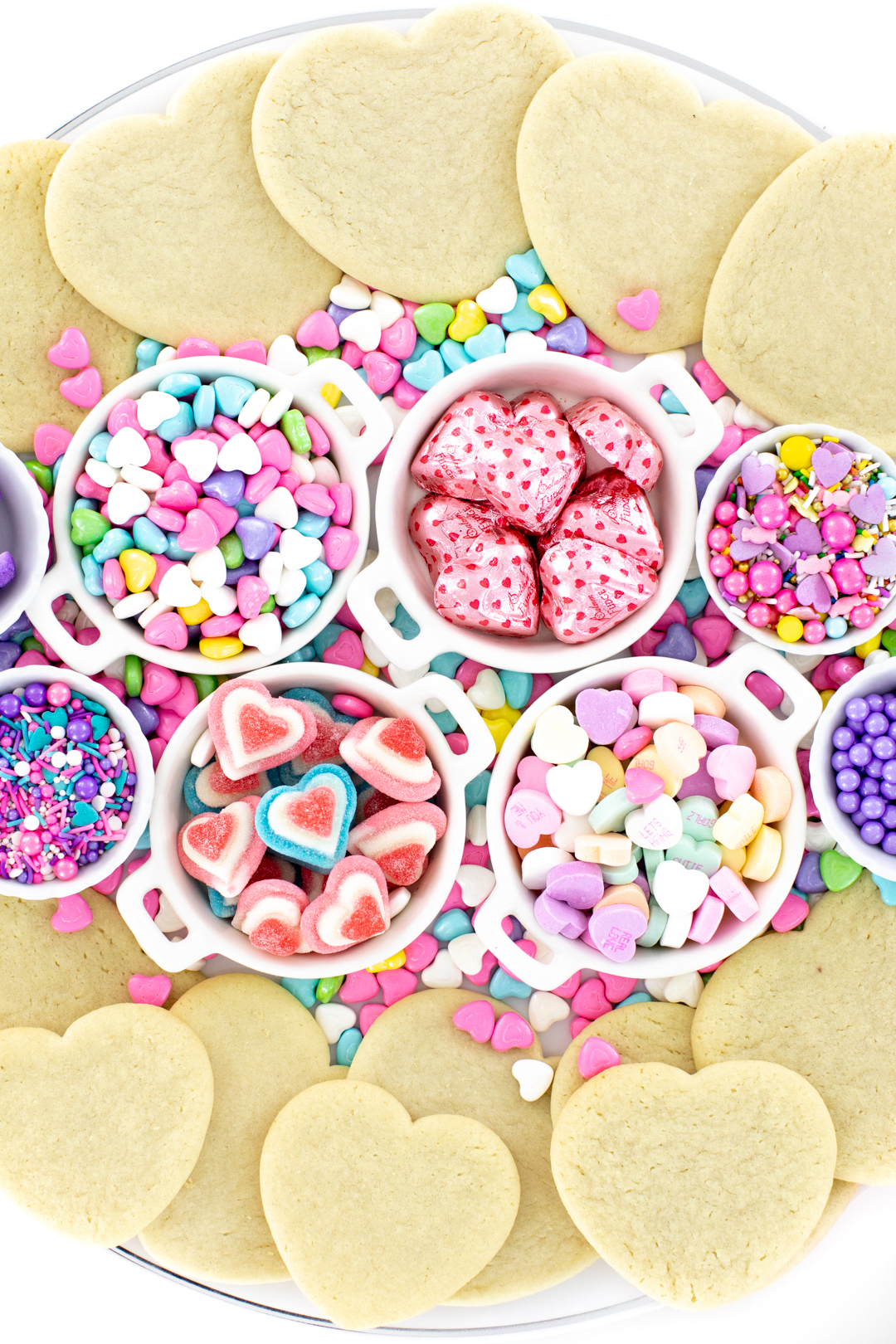valentines day cookie tray with candies and sprinkles