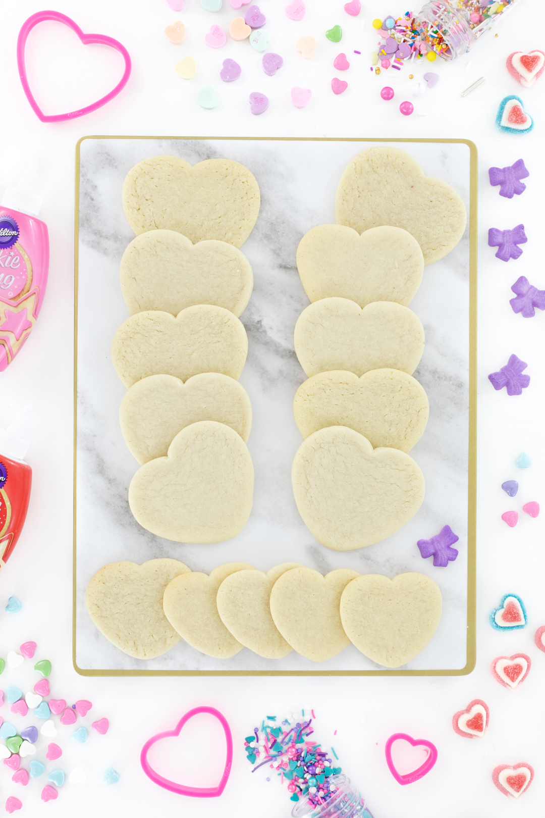 Tray of plain heart sugar cookies to decorate