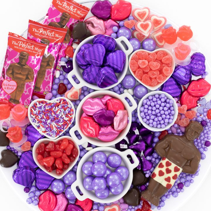 Galentine's Day Themed Candy Charcuterie Board loaded with red and purple candies.