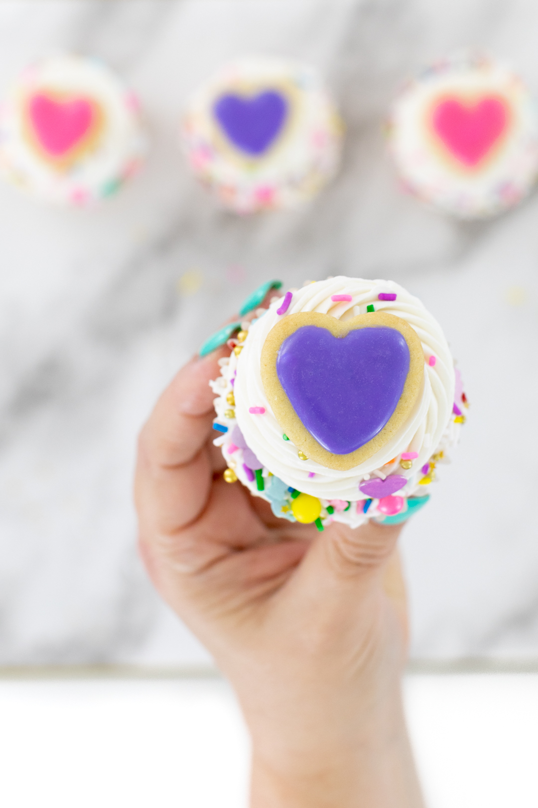Mini Heart Cookie on top of cupcake