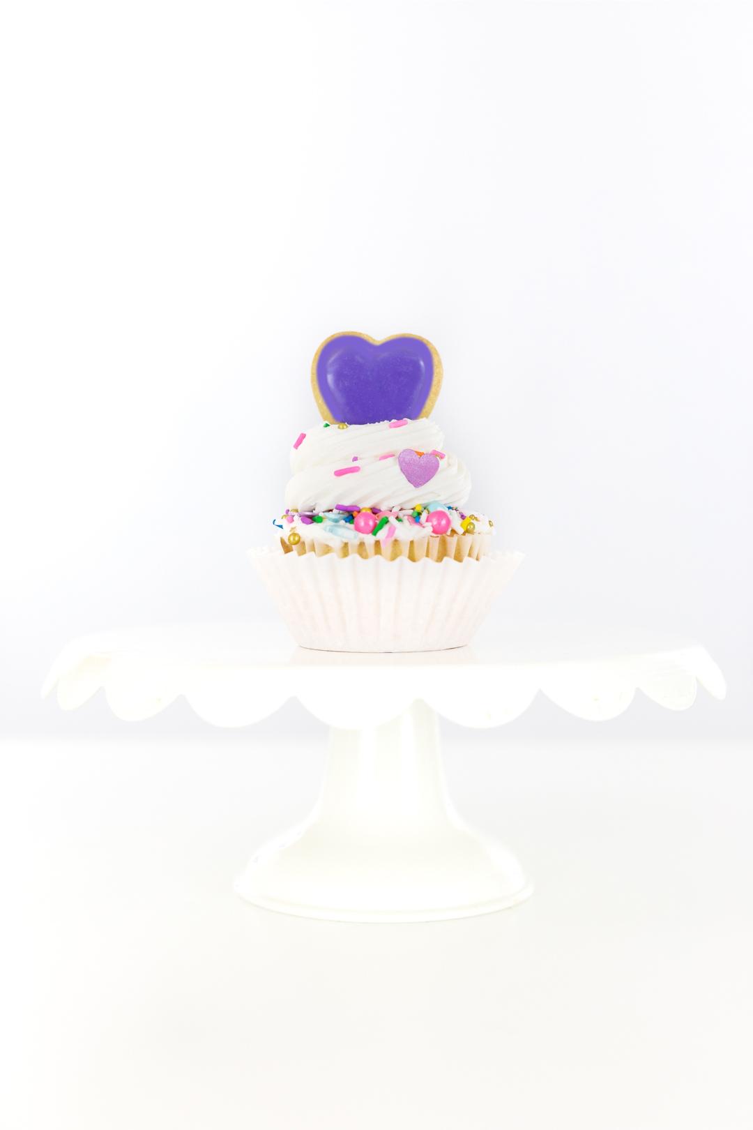 purple heart on top of cupcake