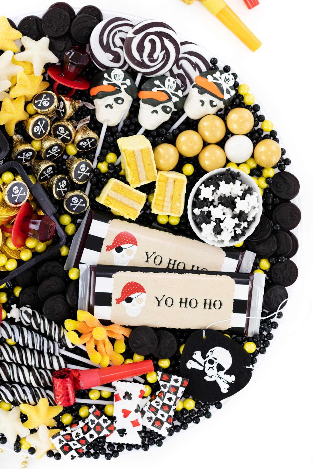 pirate party platter with skeleton lollipops and gold candy.