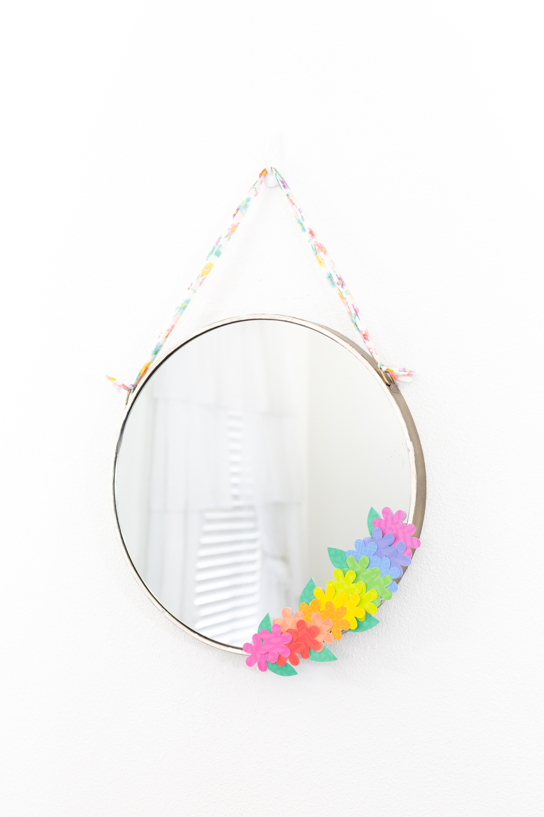 beautiful round mirror with paper flower decoration