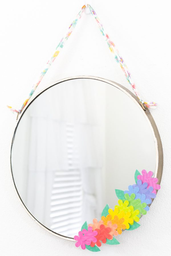 round mirror craft with rainbow faux flowers