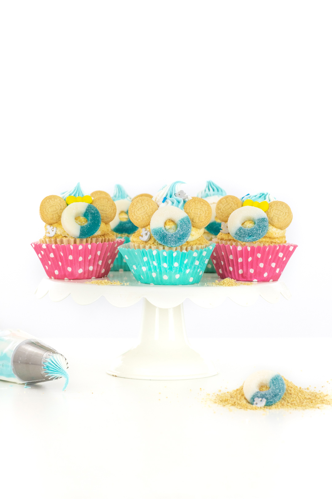 disney cruise cupcakes with polka dot cupcake wrappers pink and teal