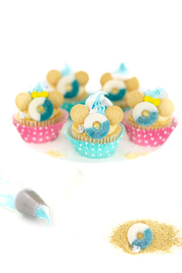 cruise inspired disney cupcakes with mickey and minnie made with ring candy for a life preserver
