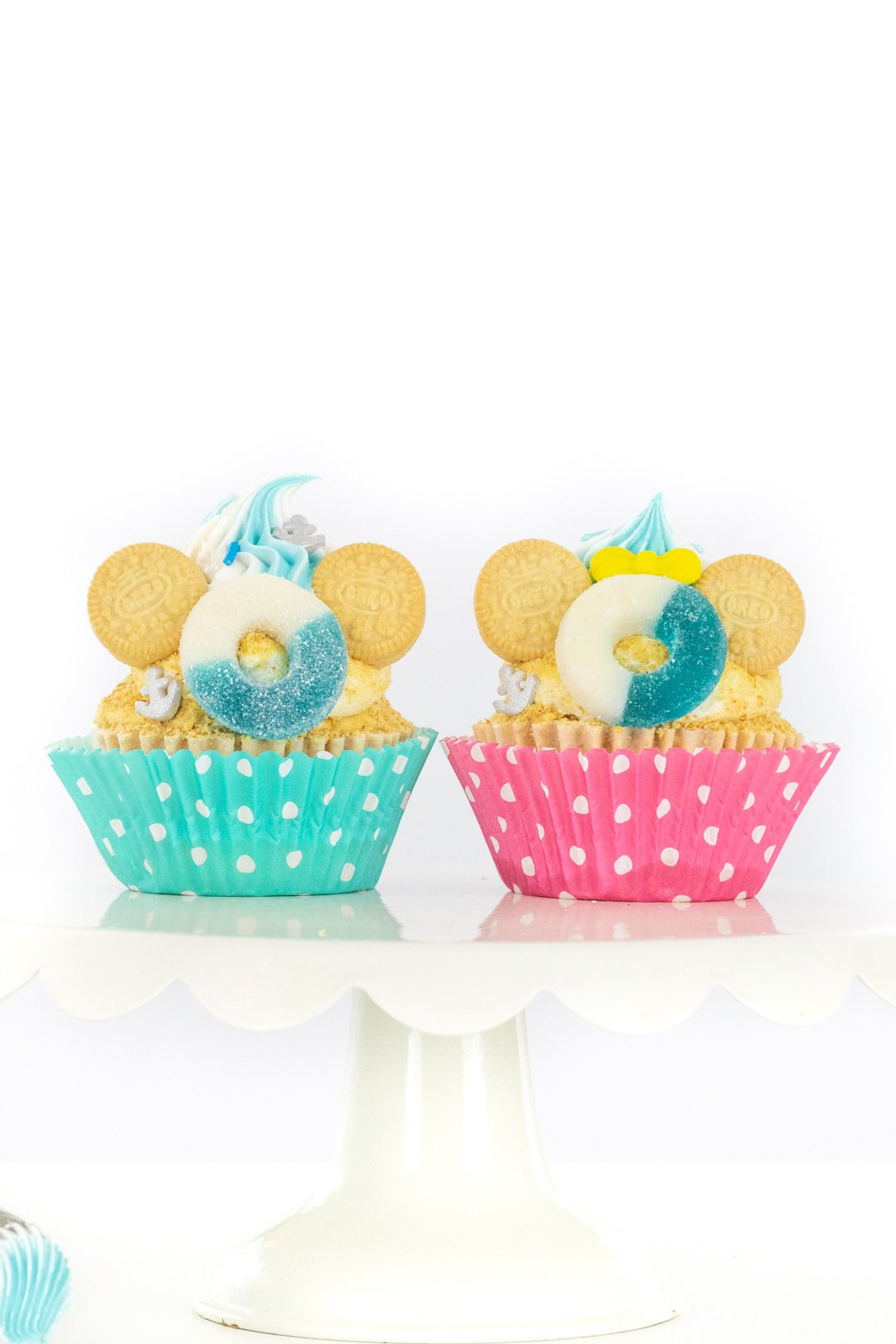minnie and mickey cupcakes that are inspired by a disney cruise with graham cracker crumbs for sand