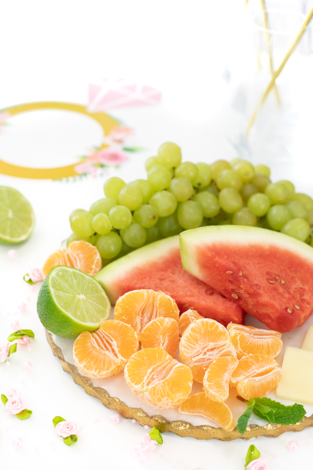 fruit tray with grapes, mandarin oranges and watermelon