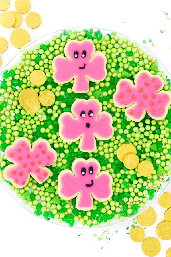 pink st. patrick's day cookies with funny faces and polkadots