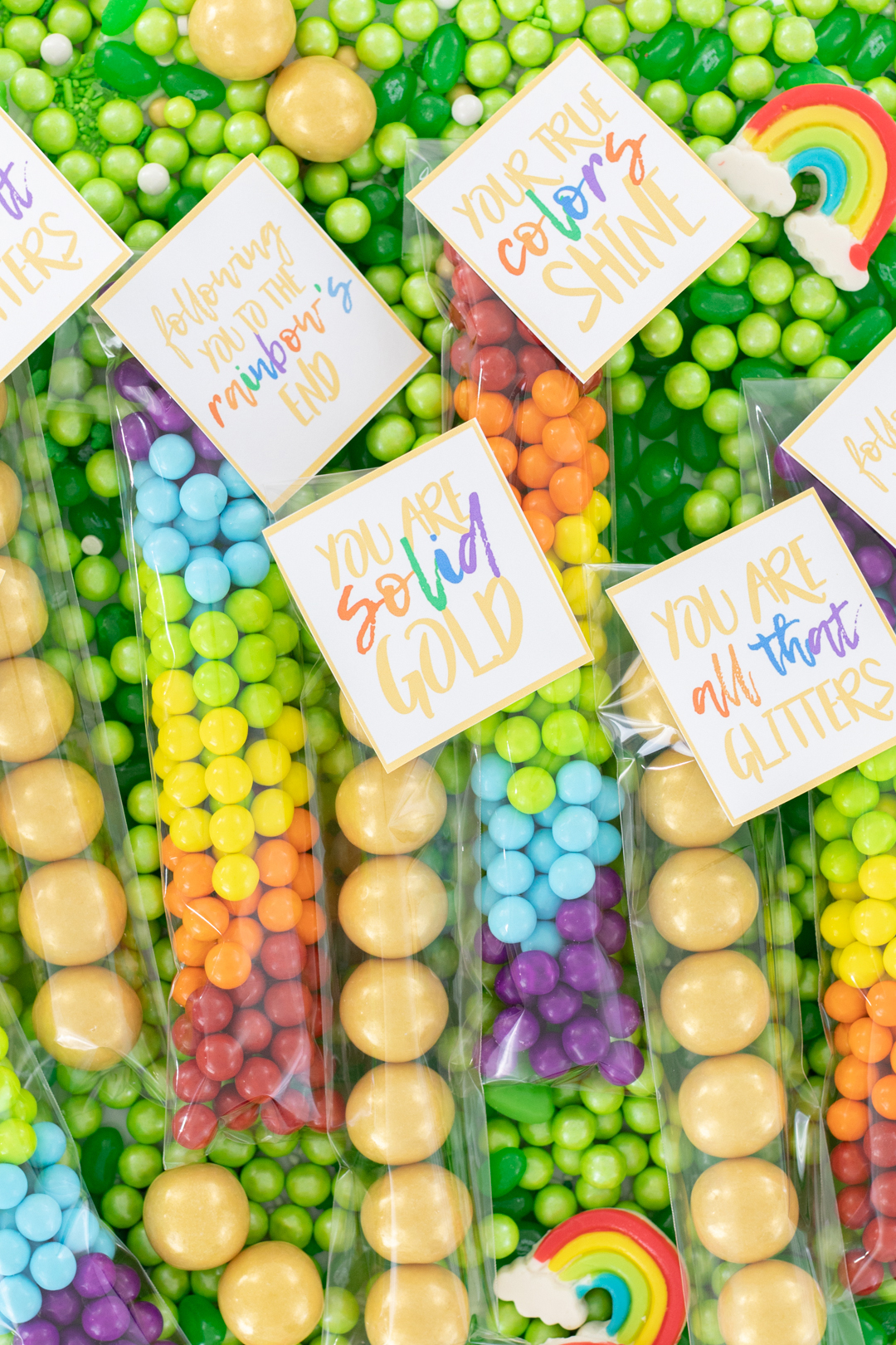 treat bags for st. patrick's day with gold gumballs and rainbow sixlets