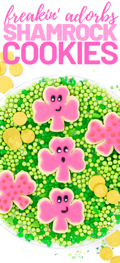 Cute pink shamrock sugar cookies with Kawaii style smiley faces for St. Patrick's Day.