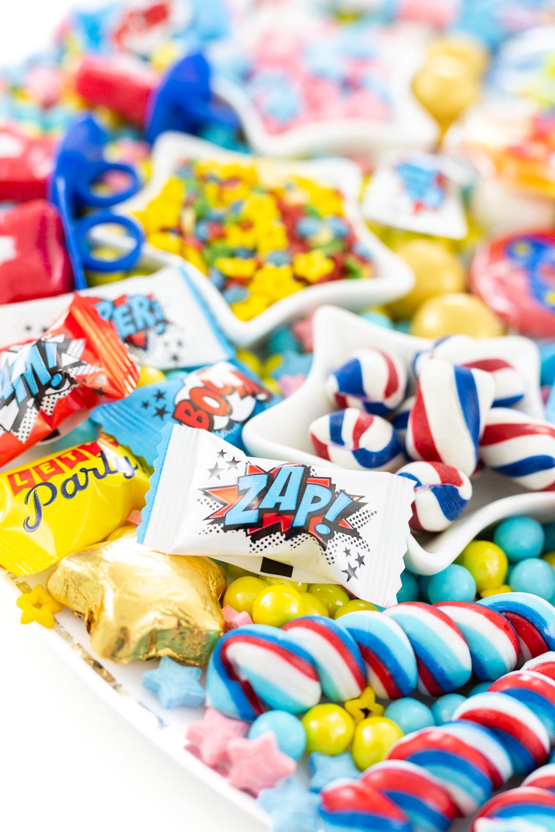 superhero candies with sayings like zap, bam.