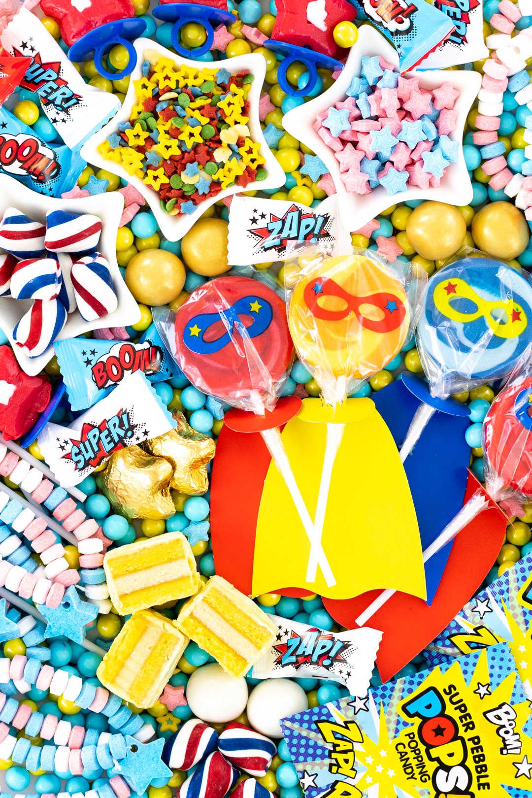 superhero candies, lollipops, cakes, candy sticks and buttermints