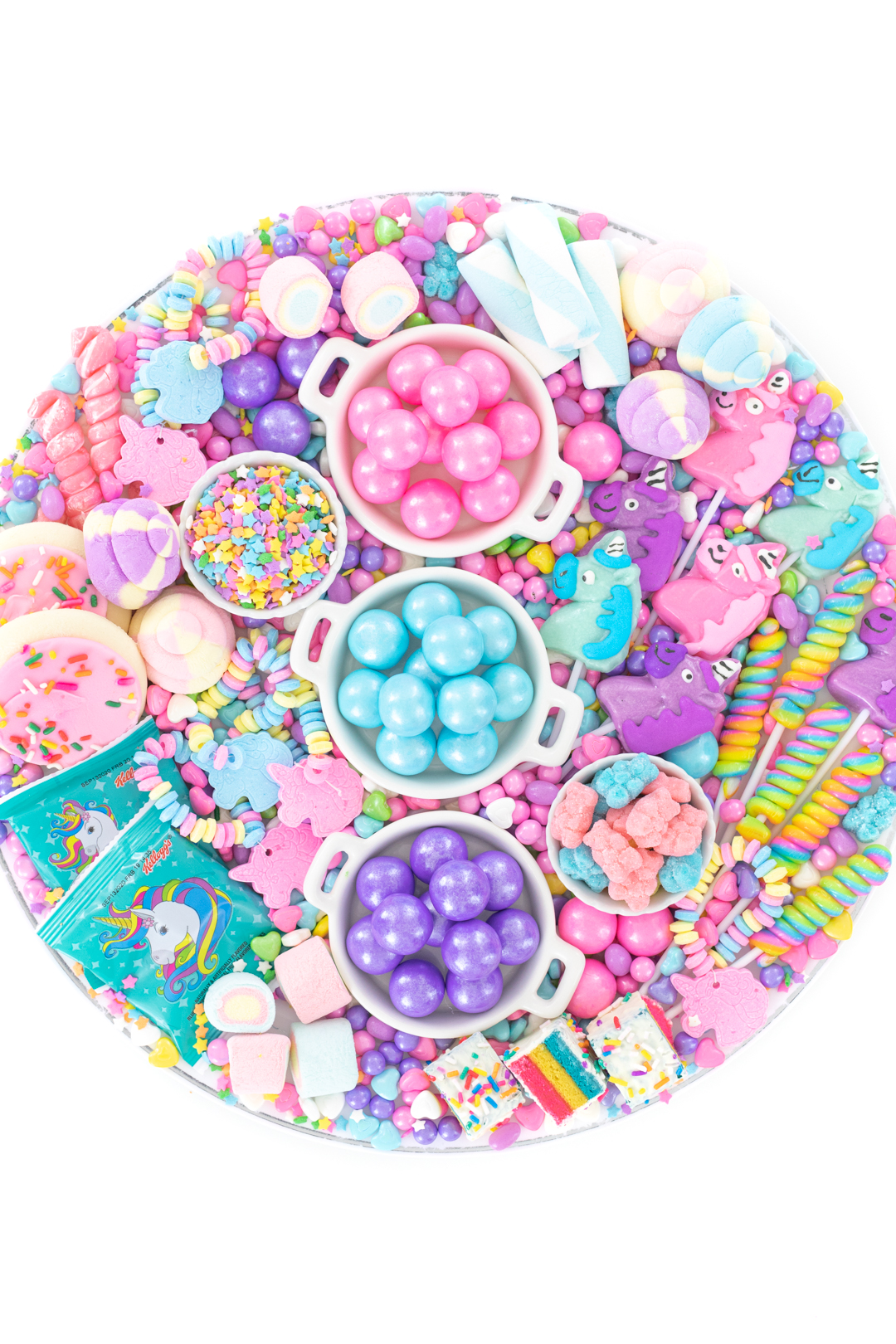unicorn charcuterie board with pastel unicorn shaped candy