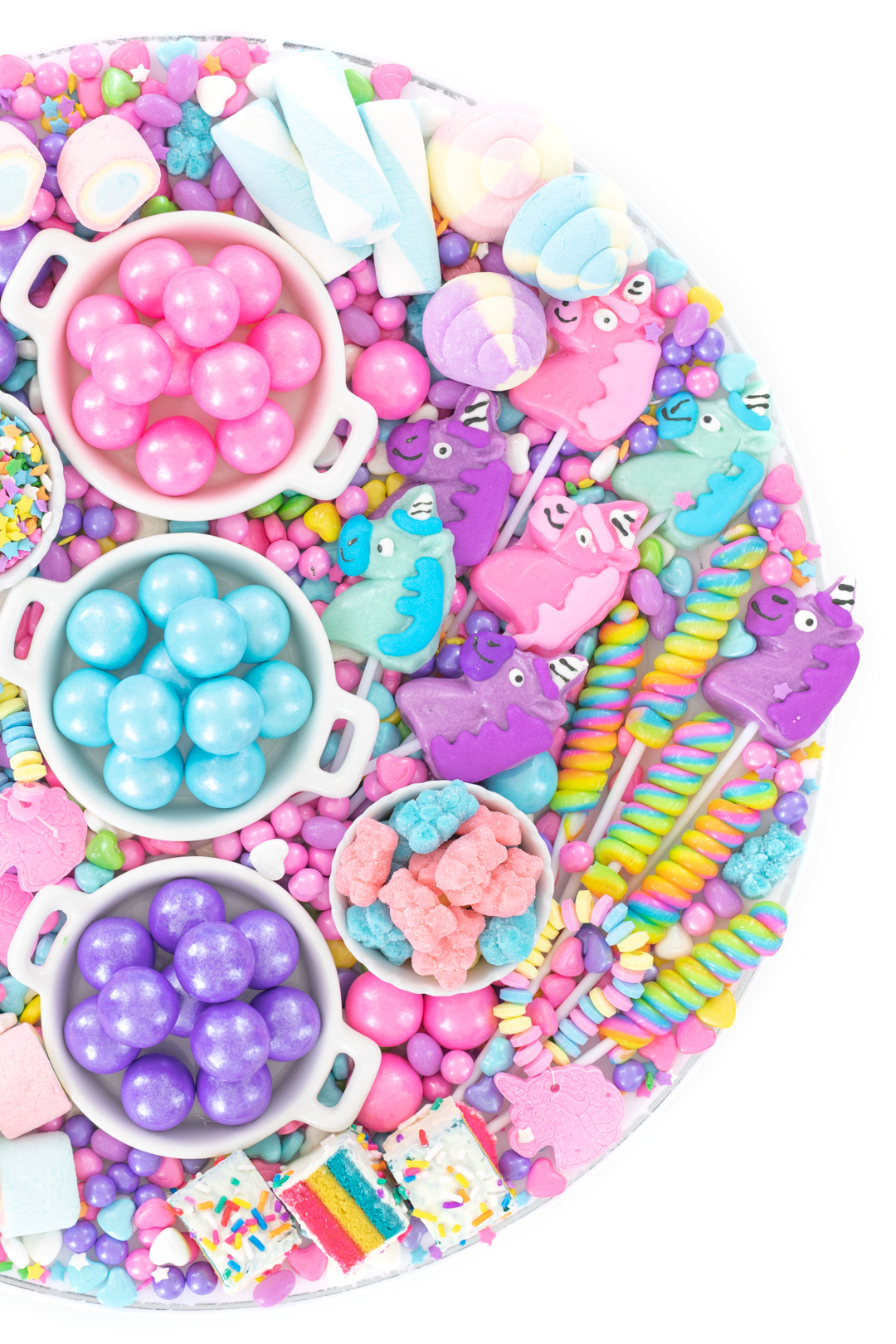 tray of pastel pink, blue and purple candy and gumballs