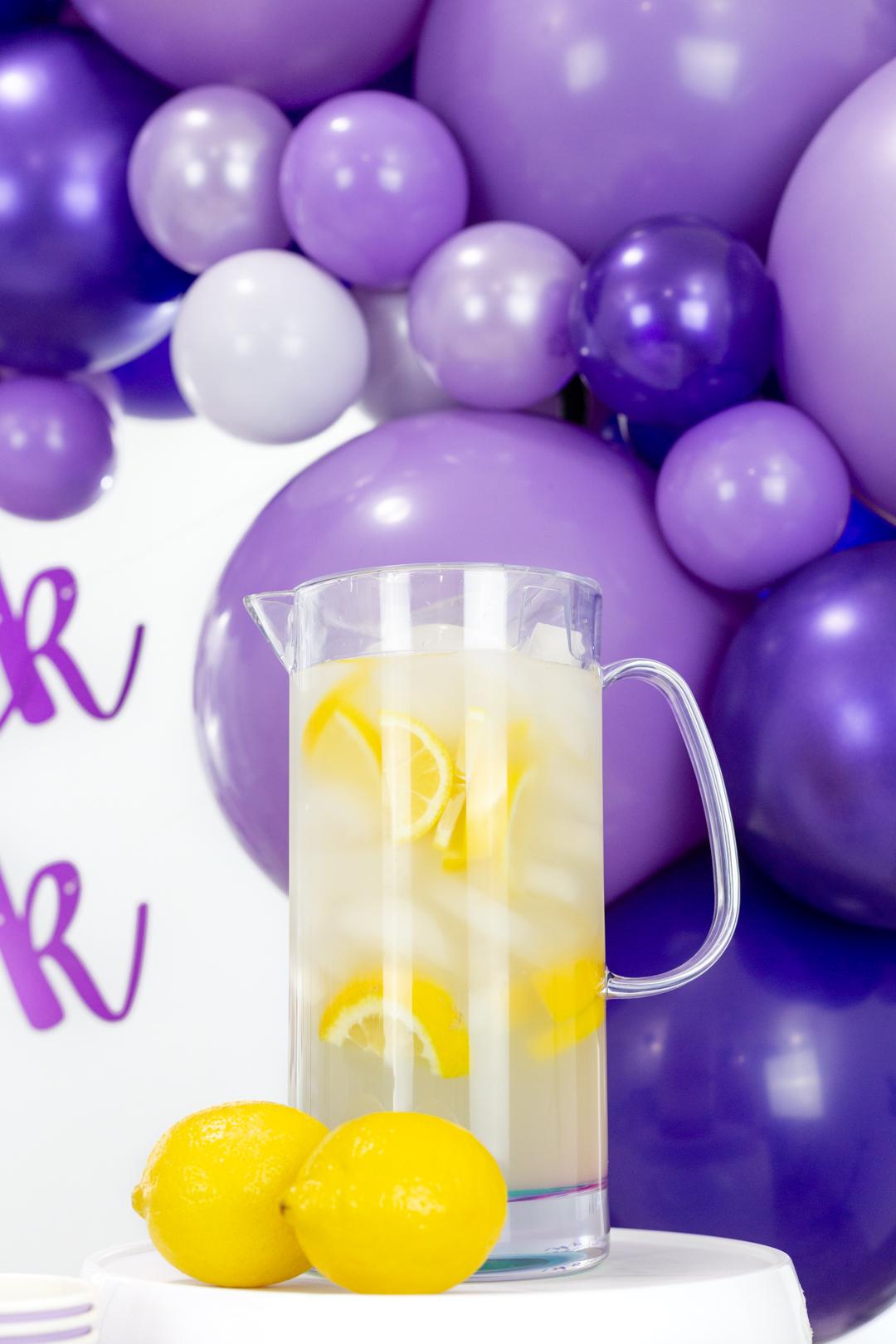 pitcher of lemonade with fresh lemon slices