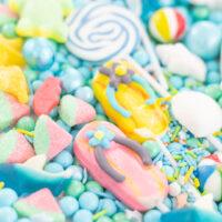 flip flop sandals, watermelon candies. beach candies on a tray