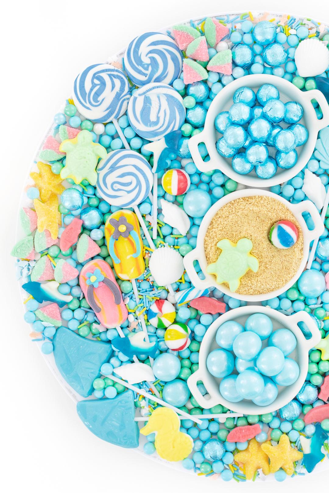 candy platter with a beach theme. flip flop lollipops, sea creature gummy candies