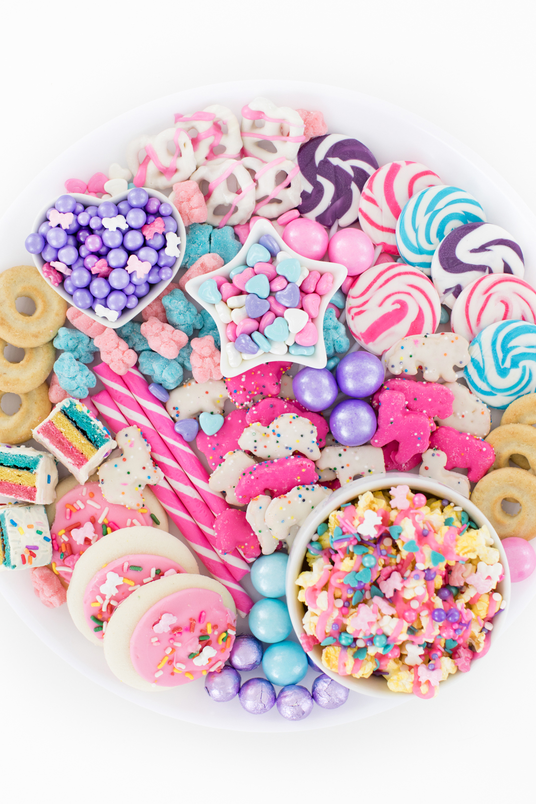 pretty pastel snack tray with popcorn, candy sticks, gumballs, pastel covered pretzels
