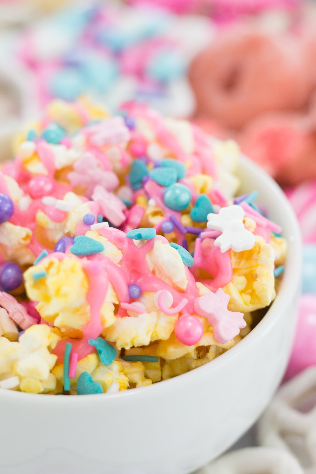 pastel popcorn with pink icing and sprinkles