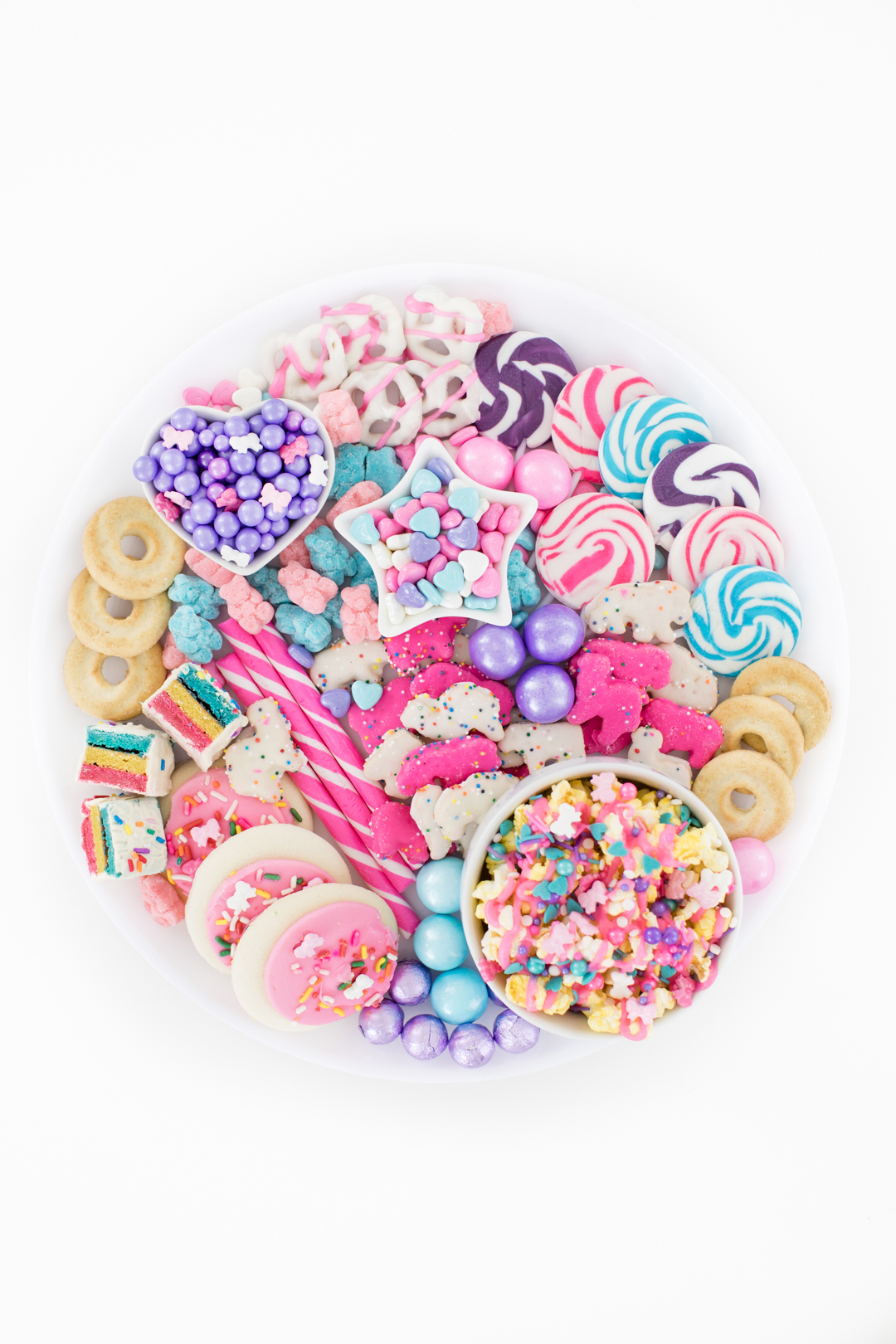 round dessert snack tray filled with pastel treats
