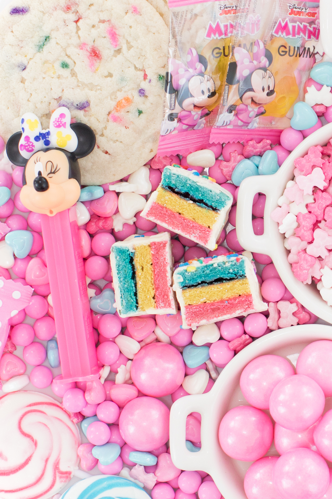 candy tray up close with minnie mouse pez dispenser and cakebites party cake