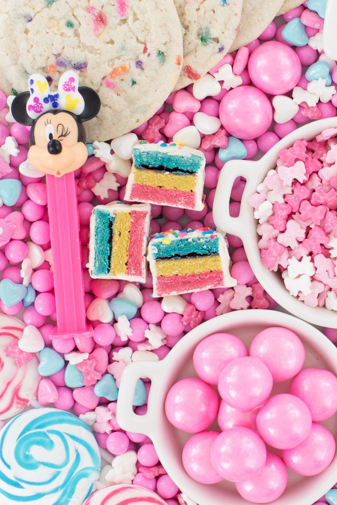 Minnie mouse pink candy board and party cake bites