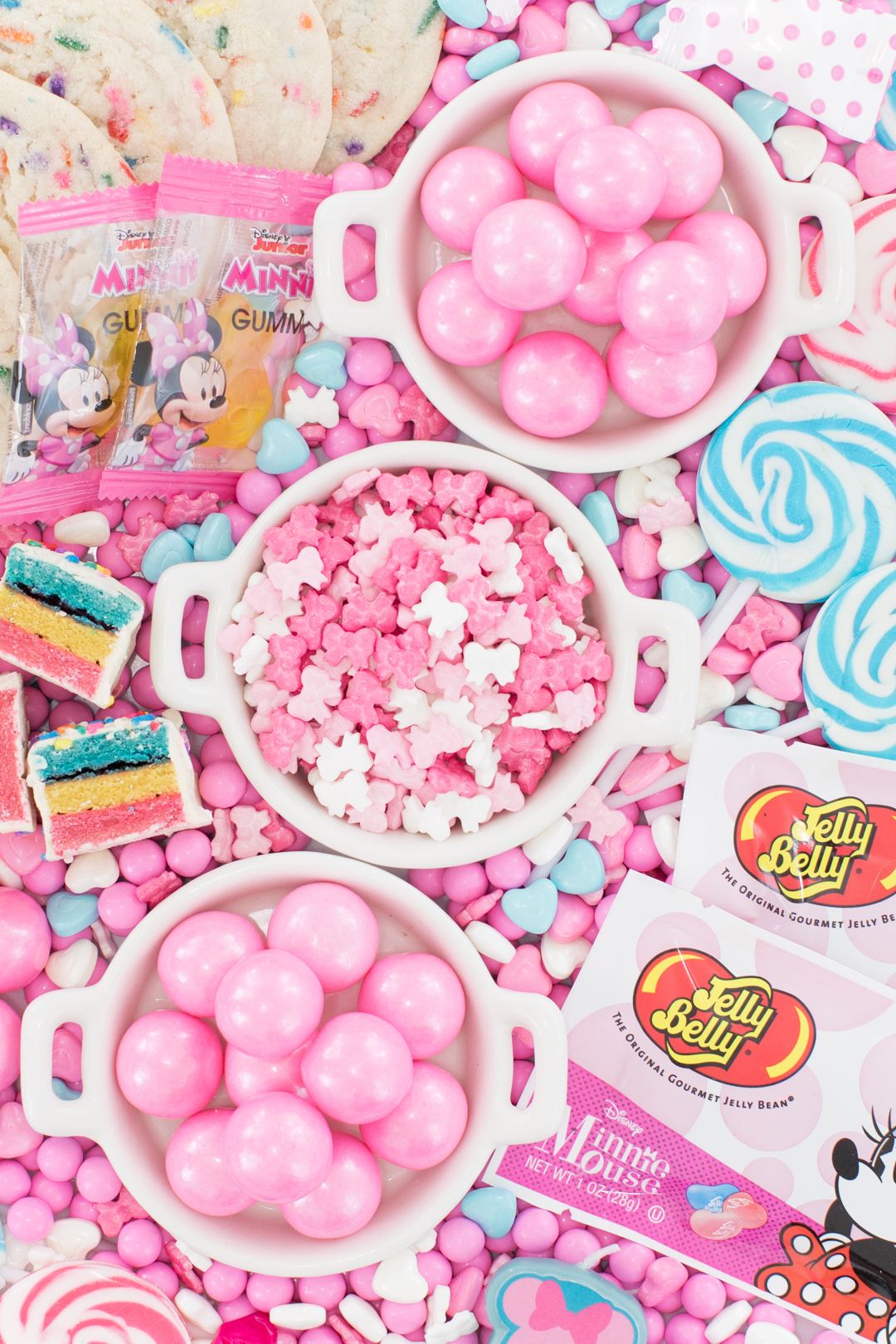 pretty pink candies in small dishes on top of a larger candy platter