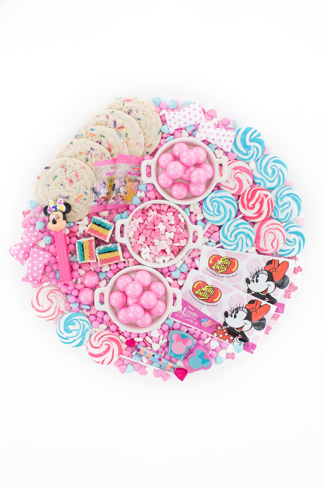 disney minnie mouse candy charcuterie board with pink and blue candies