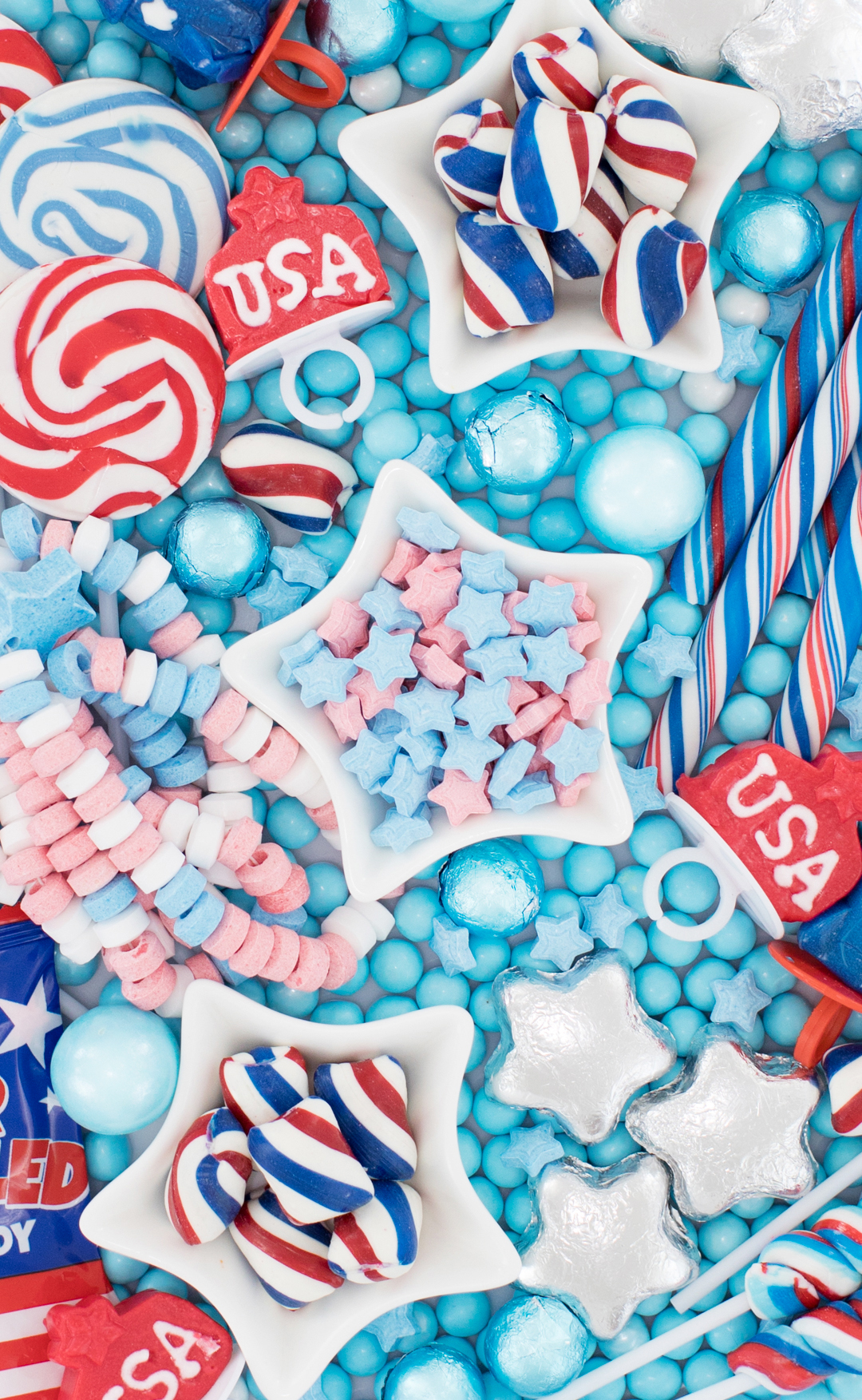 Candy platter with red, white and blue picks.