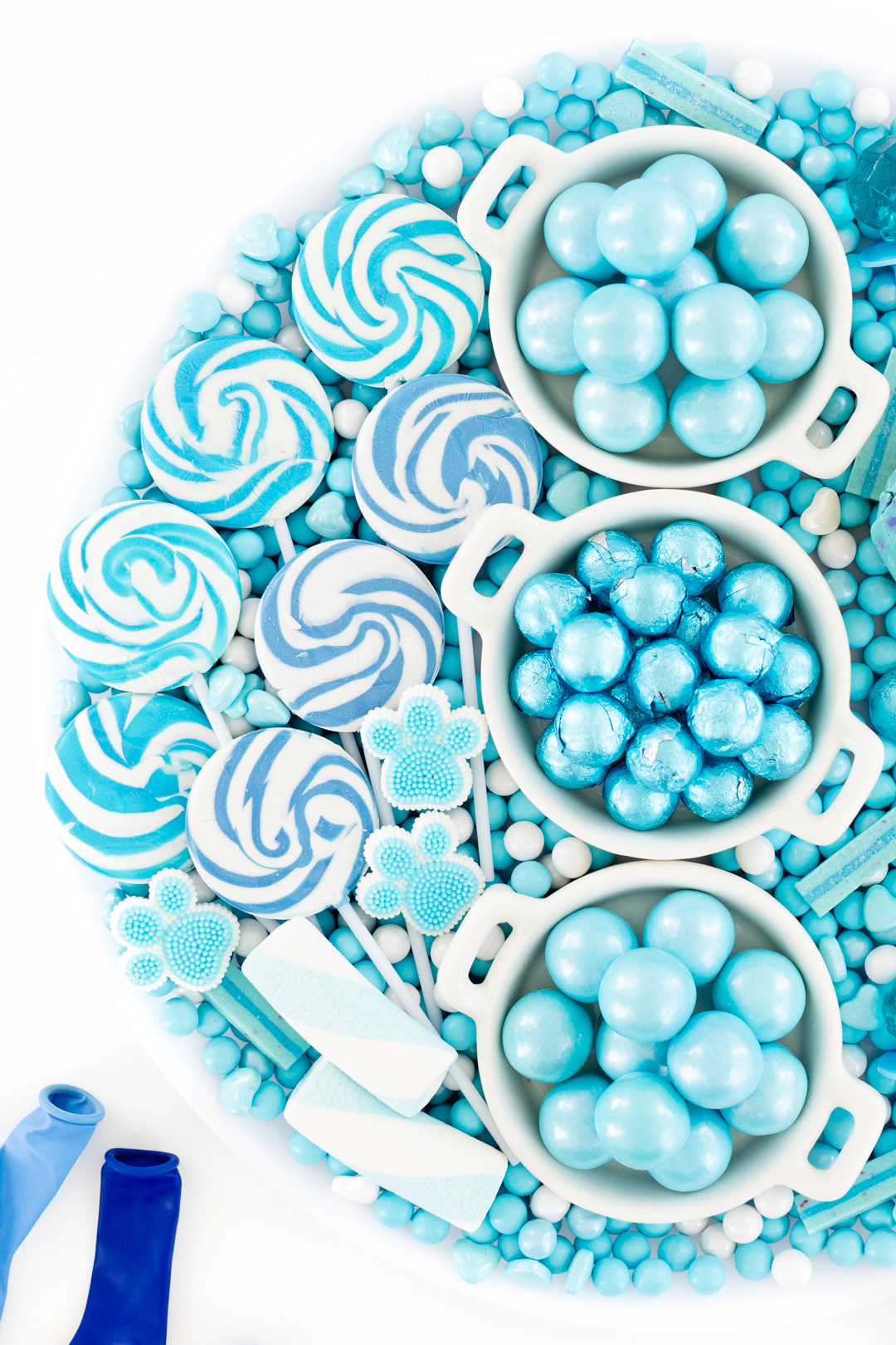 candy board with swirl lollipops in various shades of blue