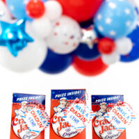cracker jack boxes lines up with a 4th of july gift tag tied onto them