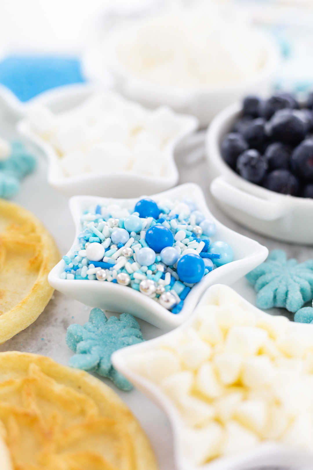 pretty frozen movie or cinderella inspired sprinkle mix with shades of blue, white and silver