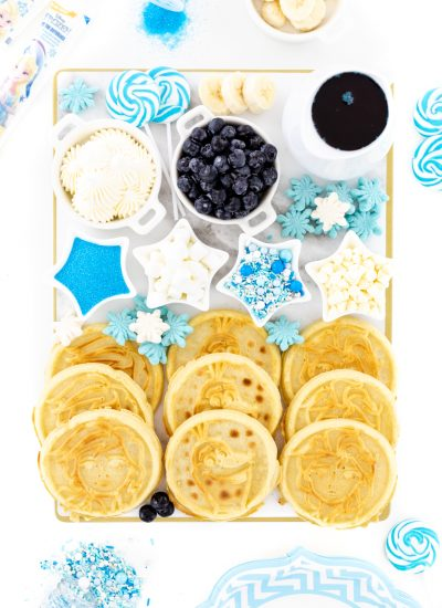 Waffle Board with fun matching sprinkles, fruits and blue syrup.