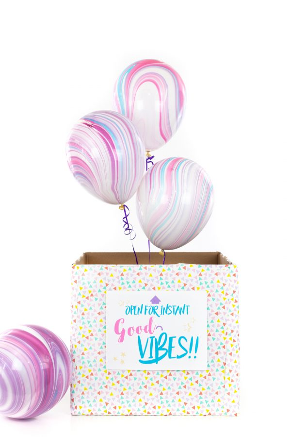 balloons popping out of a box surprise