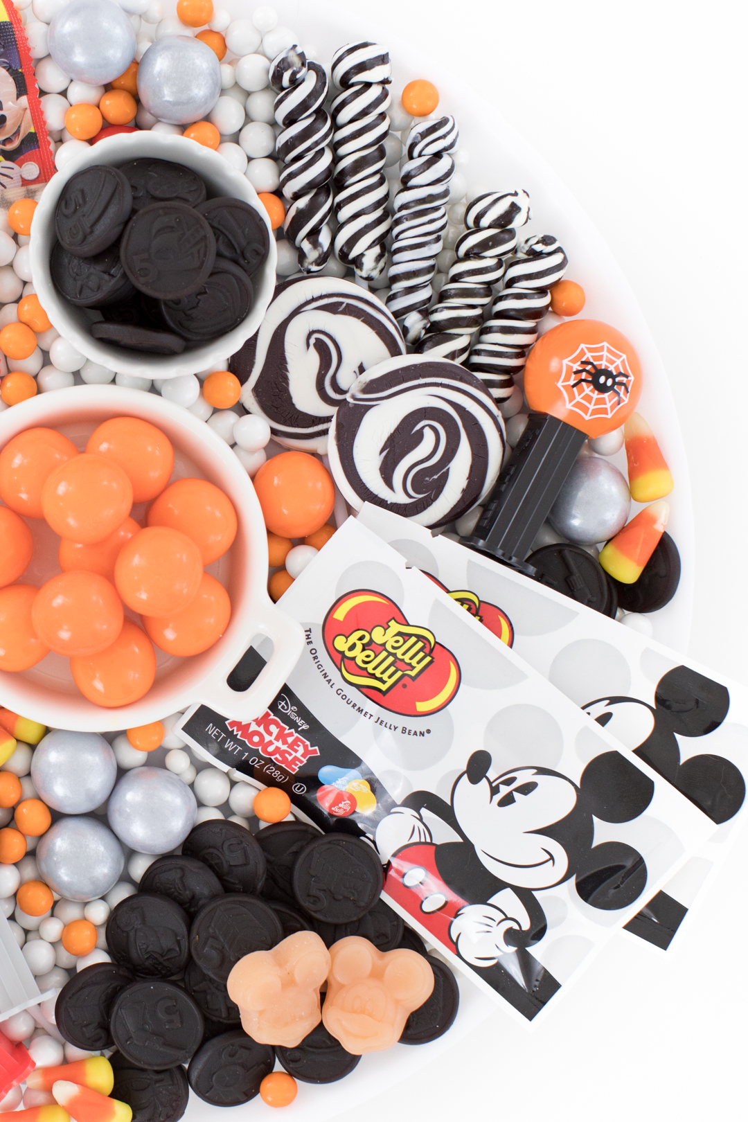 Mickey Mouse Halloween Candy Charcuterie Board with Jelly Belly and Swirl Lollipops.