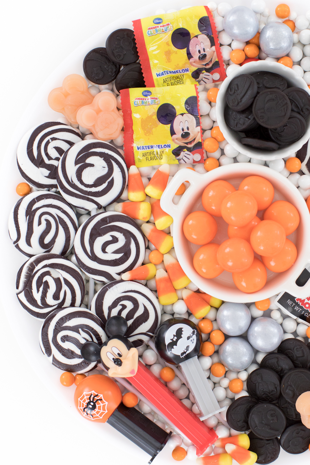 Black, white and orange themed halloween candy platter with Mickey Mouse theme.