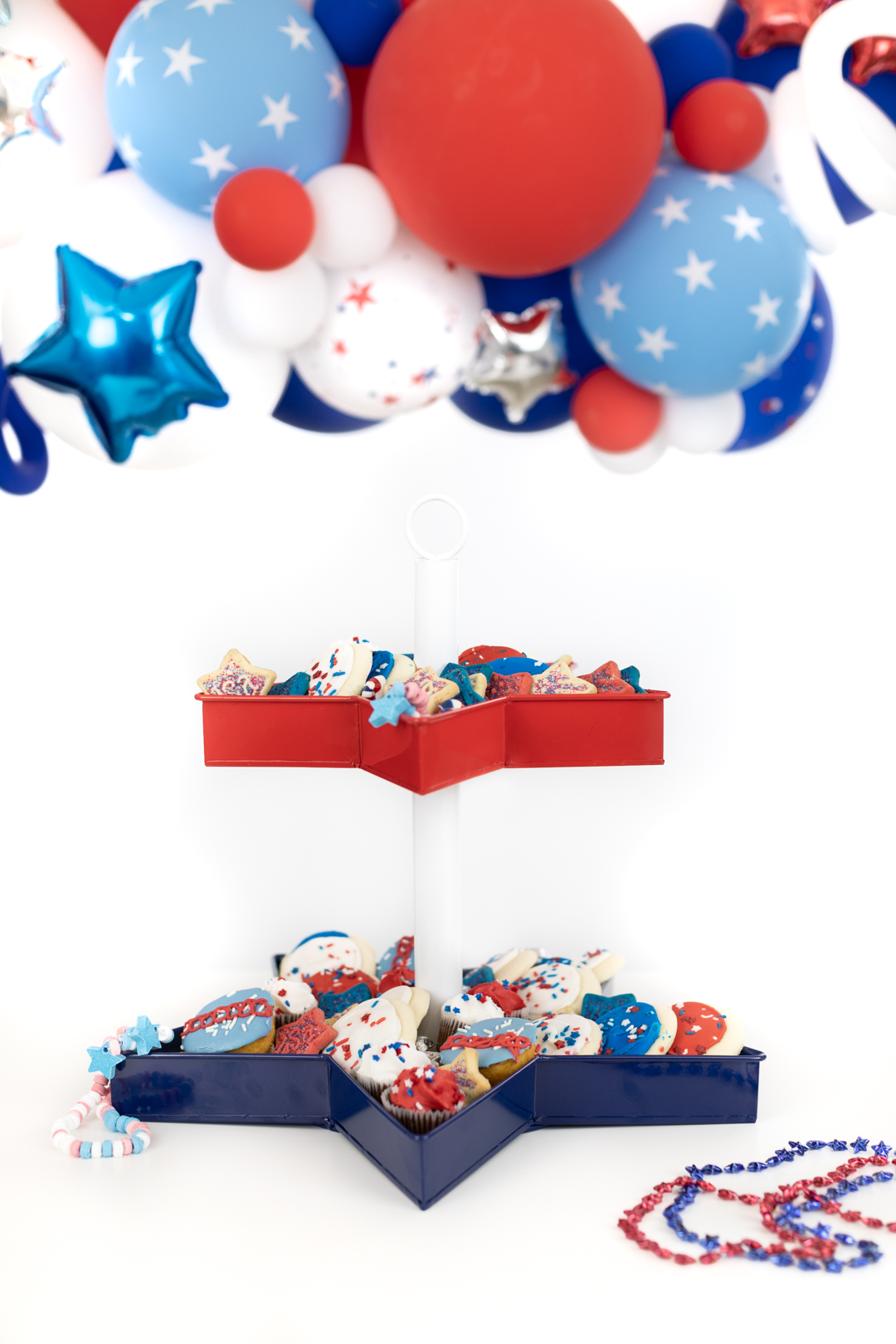 patriotic tiered serving tray filled with sweets