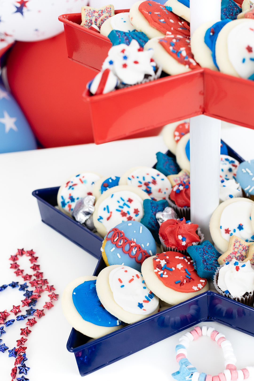 up close of red white and blue desserts. Cookies, cupcakes and candy.