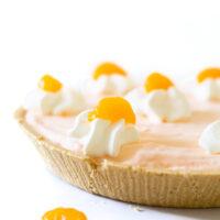 mandarin orange pie close up with whipped cream and mandarin orange garnish